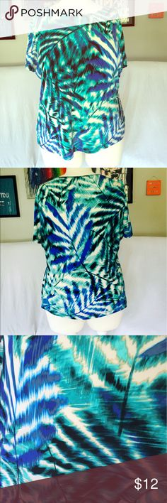 Bright Colorful Top The colors are gorgeous! Pattern reminds me of ferns or palm trees. Perfect for layering under a blazer to get that pop of color we all love. East 5th Tops Tees - Short Sleeve