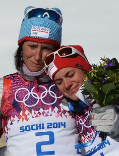 Norway's Marit Bjoergen and Heidi Weng hugged and cried after taking home the gold and bronze medals for the women's 15-kilometer skiathlon.