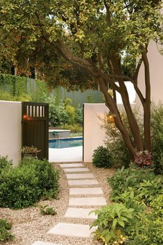 Marg Helgenberger, longtime star of CSI, gives her classic Los Angeles garden a second life as a glamorous Mediterranean-style retreat with plenty of space and style for backyard entertaining.  Photo by: Jack Coyier