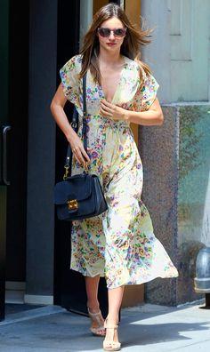 MIranda Kerr- hitting it out of the ball park - again Mui Mui bag + vintage dress. Chic!