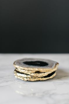 DIY Gilded Agate Coasters to craft for the holidays: http://www.stylemepretty.com/living/2015/12/09/diy-gilded-agate-coasters/ | Photography: Ruth Eileen - http://rutheileenphotography.com/