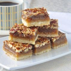 The Best Pecan Pie Bars - this easy recipe includes a simple shortbread bottom and a one bowl mix & pour topping. Tips for baking and cutting them are included. # Easy Recipes baking The Best Pecan Pie Bars - so quick & easy to make! Pecan Desserts, Just Desserts, Delicious Desserts, Yummy Food, Baking Desserts, Desserts With Pecans, Recipes With Pecans, Southern Desserts, Potluck Desserts