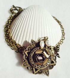 Round locket with with rose, freshwater pearls and butterfly