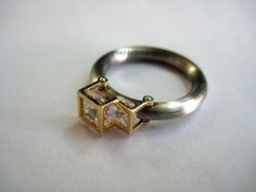 Ring: stainless steel, gold, zircons www.i-techne.pl