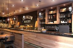 Black bricks & wood -Bakery Concept | Interior visualisations via ronenbekerman