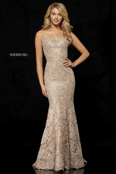 132879f505a46 Sherri Hill 52348 is a metallic lace mermaid gown with spaghetti straps and  an open lace up back.