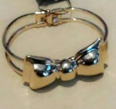A big golden stainless steel bow bracelet with a snap clasp.beautiful fits all sizes its so bold and beautiful. Wedding Bows, Wedding Ideas, Bow Bracelet, Bracelets, Sweet 16 Party Favors, Golden Bow, Bridesmaid Accessories, Baptism Gifts, Big Bows