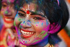 Young Indians adorned with colored powder take part in celebrations for the spring festival of Holi in Bhubaneswar on March 16, 2014. Holi, the popular Hindu spring festival of colors is observed in India at the end of the winter season on the last full moon of the lunar month. (Asit Kumar/AFP/Getty Images) Holi 2014: The Festival of Colors - In Focus - The Atlantic