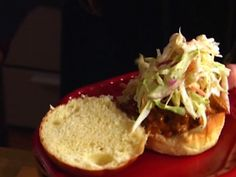 Tyler Florence's Pulled Pork Sliders w/tangy sauce. Easy to make, good to eat. Tip: Go easy on the cider vinegar in the sauce. Mix the rest and add vinegar to taste. Hawiian Bread buns make the sliders!