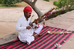Street musician - Street musician playing traditional instruments in Jodhpur, India
