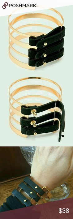"""Gold and Black Suede Cuff Bracelet LIMITED EDITION!  GORGEOUS cuff bracelet in gold with black suede fasteners!  Definitely a street style must have!  2""""H. 2.5"""" D. Metal alloy. Jewelry Bracelets"""