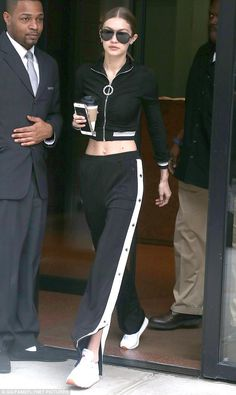 Sporty spice! Gigi Hadid stepped out in style on Friday, showing off her flat abs in black and white sweats