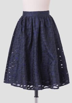 Beautifully crafted in soft cotton, this chic black midi skirt features navy geometric-shaped cutouts with sheer mesh inserts. Finished with a partially elasticized waistband and a hidden back ...