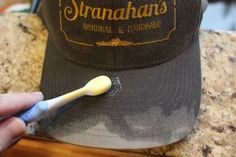 How to Clean a Baseball Cap - Shampooing the bill of the ballcap.
