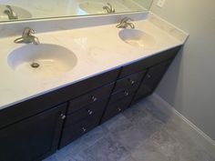 Double sinks in master bathroom with marble counter tops.