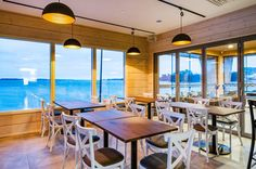 Café Nokkalan Majakka, built with Honkarakenne's non-settling logs, represents ambitious and modern wood construction in maritime surroundings. Wood Construction, Lighthouse, Windows, Building, Modern, Table, Logs, Furniture, Home Decor