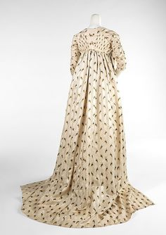 This lovely overdress indicates the fine craftsmanship and textiles used at the end of the 18th century to coordinate with the exaggerated fashions of the high waist, large headdresses and skimpy silhouettes