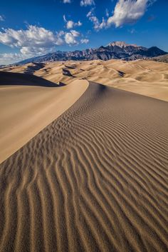 The peaks of The Sangre de Cristo mountain range just beyond the dune field of The Great Sand Dunes - Colorado.