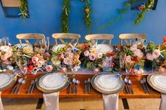 Colorful blue and pink wedding centerpiece - centerpiece with pink garden roses, blue delphinium, ranunculus, proteas, and starfish - Check out more beach centerpiece inspiration on WeddingWire! {Florunique}