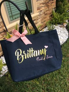 THE PERFECT GIFT FOR THE BRIDESMAID, MAID OF HONOR AND BRIDE    PERSONALIZED HEAT TRANSFER VINYL THE TOTE BAG IS SIZE  12h x 14w x 6.5d, Approx. 1,092 cubic inches  Product Description: 600 denier polyester Large main section with small interior self-fabric pockets Left side exterior pocket Web handles