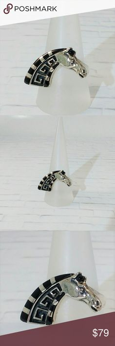 JUST IN ♦ Sterling Silver & Black Onyx Horse Ring The black onyx cabochon gemstones are set in a striking sterling silver horse ring. The highly polished silver ring also has an oxidized effect to highlight its detailing. New.  Measurements and weights are approximate. Photos may be enlarged to show detail. Jewelry Rings