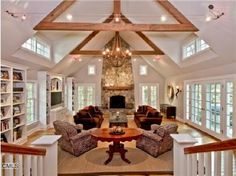 beamed ceilings, stone fireplace and built-in tv= pretty spectacular room