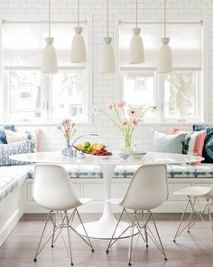 Cutest little eating nook - Mid century white chairs + bench seats | Color Theory Boston