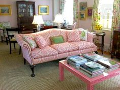Meggie H. Interiors pink living room. I love this room, it makes me feel like I am in Bermuda or West Palm Beach.