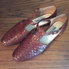 Woven flats Brown woven leather flats with subtle mahogany tone. Excellent preowned condition, only flaw is subtle scruff at back of one heel (see pic #4). Size 10 N, but has stretch in the toebox due to the woven leather. Trotters Shoes Flats & Loafers