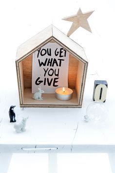 Little christmas house with quote. Cute.