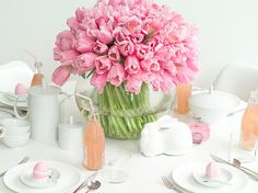 Short on time this Easter? Keep the centerpiece simple but stunning. Tons of pink tulips make a statement.get more tulips than you think. TIP: drop a penny in the water. The copper will keep the tulips upright and lively longer! Tulpen Arrangements, Floral Arrangements, Flower Arrangement, Easter Table Settings, Pink Tulips, Pink Flowers, Pink Roses, Easter Flowers, Pretty Flowers