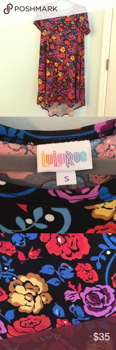 Brand new (wot) LuLaRoe Carly dress The LuLaRoe Carly is a perfect throw and go!  Never been worn, no tags.  Super soft cotton material. These run BIG!  I normally wear a large/12 XS small fits in Carly! LuLaRoe Dresses High Low