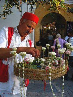 Selling 'jasmine machmoum' in Tunisia.