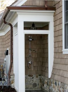 outdoor shower...love how this is beautifully blended into the architecture of the house