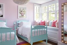 Contemporary pink and turquoise shared girls' bedroom