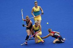 United States' Lauren Crandall, left,and teammate United States' Alyssa Manley fight for the ball with Australia's Edwina Bone, center, during a women's field hockey match atthe 2016 Summer Olympics in Rio de Janeiro, Brazil, Monday, Aug. 8, 2016. (AP Photo/Dario Lopez-Mills)