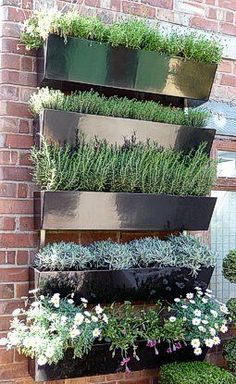 Urban Garden IG NOTE: I saw the coolest vertical garden wall piece made from stainless steel- could take the place of art in the kitchen. - 10 Square Foot Gardening Ideas you can use no matter where you live! Small Gardens, Outdoor Gardens, Dream Garden, Home And Garden, Garden Modern, Vertical Garden Wall, Vertical Gardens, Vertical Planter, Tiered Planter