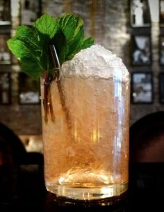 The Coco Chanel Cocktail: Named after the iconic designer, this chic cocktail features Lillet, Bergamot, and Champagne, and includes a Chanel No. 5-infused spearmint garnish. #cocktailrecipes