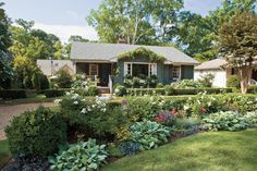By carefully sculpting the landscape and choosing the right plants and materials, you can hide your unattractive driveway. Start by creating a slightly raised island of lawn in the center of the drive. Then, add a low boxwood hedge toward the back of the island with roses, annuals, and perennials rising above the hedge in the front. Blend a variety of colors, textures, and heights for a great look. Try 'Crystal Fairy' rose for height, lamb's ears for texture, and 'Butterfly Deep Rose'…