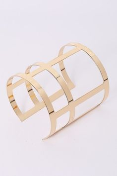Golden cut out cross cuff