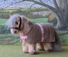 Shetland pony with lined wool rug.