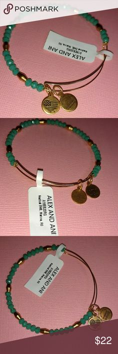 """ALEX and ANI MARINE NAUTICAL BEADED BANGLE Alex and Ani patented expandable wire bracelet in a Rafaelian gold finish made from recycled brass with two stamped charms.  Teal faceted glass beads with gold tone beads   go around the Bracelet.  Made in the USA. Fits size 6.5"""" to 7.5"""" wrist.  Brand New with tags and never worn. Alex and Ani Jewelry Bracelets"""