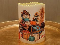 Thanksgiving LED Pillar Candle With Two Scarecrows, Pumpkins, Sunflowers, Fall Leaves, Rocking Chair And More. by DontForgetTheFlowers on Etsy Fall Candles, Flameless Candles, Pillar Candles, Decorative Candles, Wedding Gifts For Bride, Thanksgiving Centerpieces, Scarecrows, 5 Hours, Fall Leaves