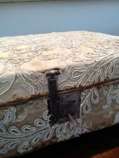 Altered vintage suitcase with lace appliques