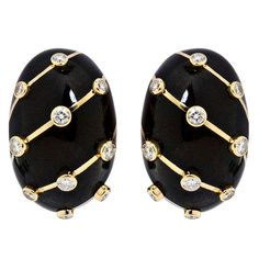 A pair of 18 karat yellow gold and black enamel earrings with bezel set diamonds by Jean Schlumberger for Tiffany & Co. Signed, with French Hallmarks. No. 5935