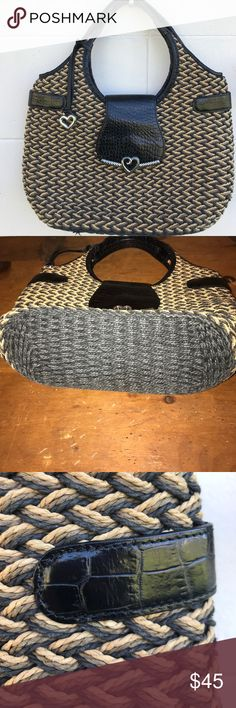 BRIGHTON HANDBAG Super clean and stylish tan and brown Brighton hand woven wicker / leather satchel. The heart seems a bit tarnished but the interior is perfect with 2 sipper pouches and 2 slip pockets. The handles are leather wrapped.  Please ask questions before you purchase. Smoke free home.  I am top seller and fast shipping. Brighton Bags Satchels