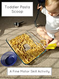 Toddler Pasta Scoop - a great fine motor activity for toddlers and little ones. No mess fun for toddlers and perfect for practicing spoon control and the skills needed for self feeding.