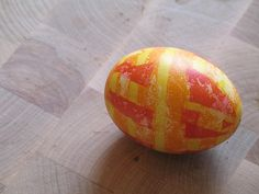 This is an egg I made by overdying while using duck tape to protect areas. They have been very popular every easter.
