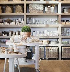 Beautiful shelves with lots of storage. I especially like the baskets with wheels on them for the lowest shelf.