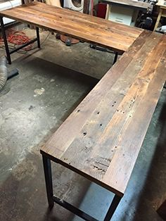 "- Reclaimed Douglas Fir ""L"" #shaped desk. - Shown with square steel tube ""U"" shaped base with black enamel coating. - Many different base options are available. ..."